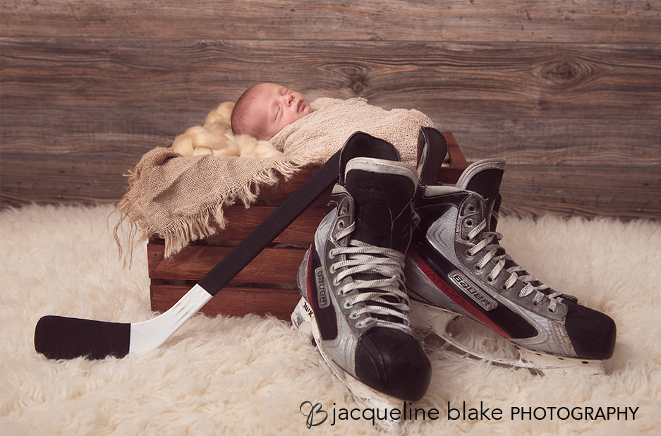 Newborn Photography with Baby Boy and Prop Hockey Skates